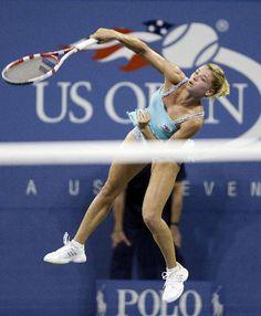 Camila Giorgi, of Italy, serves to Caroline Wozniacki, Denmark, during a third round match at the U.S. Open tennis tournament, Saturday, Aug. 31, 2013, in New York
