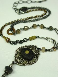 """another view of """"Machines Like Me"""" - the front,  a Lake Erie stone bolted on to a vintage badge. The collage chain is sterling, brass, tourmaline, smoky quartz, and pearl."""