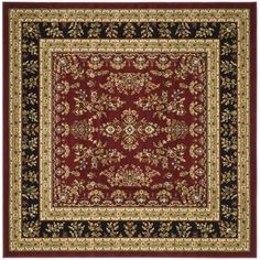 This floor rug has a red background and a black border and displays stunning panel colors of burgundy, green, gold and blue.