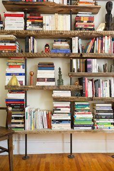 amazing rustic bookshelves in a Brooklyn bedroom. Big fan of the thick rustic shelves Rustic Industrial Furniture, Industrial Living, Industrial Shelving, Vintage Industrial, Rustic Bookshelf, Bookshelf Wall, Bookshelves In Bedroom, Library Shelves, Bookshelf Ideas