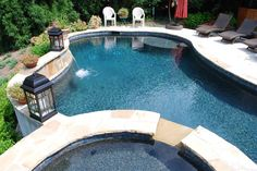 Stone Pool and Spa with Black Marble Pebble Tec Swimming Pool Designs, Swimming Pools, Pebble Tec Pool, Pool Ideas, Patio Ideas, Backyard Ideas, Pool Finishes, Pool Remodel, Backyard Buildings