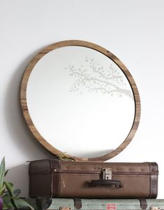 Decorate your home with delicate handmade wall mirrors for a natural vintage style. Large round mirror with a branches cross stitch design. The