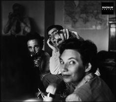 A MAGNUM PHOTOS meeting in Paris in 1950, the photographers Werner BISCHOF and Robert CAPA, and in foreground Maria EISNER the Bureau Chief//Werner Bischof