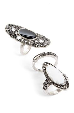 Polished stones and filigree detailing create an exquisite, antiqued effect on this trio of rings.