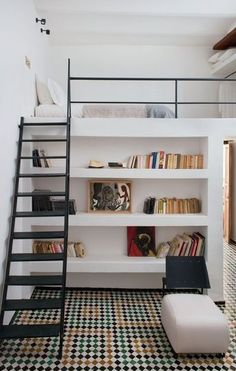 white lofted bed above bookshelves // diggin the ladder too