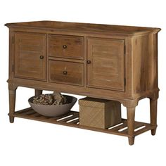 Stow spare linens or extra dinnerware in this classic buffet, showcasing a weathered sand finish and bottom display shelf for ample storage....