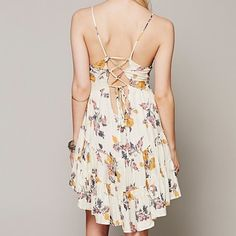 Free People • Yellow Circle of Flowers Slip Dress Barely worn, in great condition! fits true to size. Light yellow floral slip dress with cross back detail. Looks great with a statement bralet.   ❌No trades ❌No PayPal ❌No asking for the lowest price Free People Dresses Mini