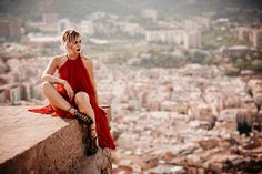 the lady in red   editorial fashion shooting in Barcelona with a view   red carpet dress from Dawid Tomaszewski and lace up heels from Elisabetta Franchi   style blogger Masha Sedgwick from Germany sitting on a roof top