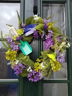 Purple and yellow wreath perfect for summer wirh small seaside spades complimenting the wreath. perfect for a summer home