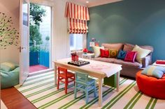 Great kid-friendly room! I like how they incorporated the kids table as a coffee table.