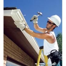 Installing new gutters. Fix or replace guttering to prevent leaks and damage.