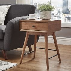 Shop for Aksel Brown Wood 1-Drawer End Table by MID-CENTURY LIVING. Get free shipping at Overstock.com - Your Online Furniture Outlet Store! Get 5% in rewards with Club O!