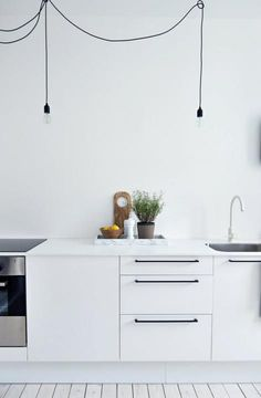 White & Modern Kitchen, Love the black long handles!