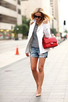 Black and white stripped shirt, white blazer, jean shorts, warm read purse, nude heels .