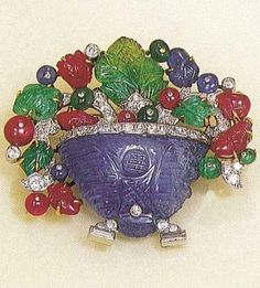 An Art Deco Tutti Frutti Flower Vase Brooch, Cartier London, Circa 1929. Composed of platinum, amethysts, rubies, emeralds and diamonds. #Cartier #ArtDeco #brooch