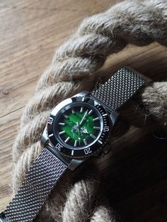 I take vintage dials with perfect patina and build unique new watches around them. This one is a quartz model with steel case, ceramic bezel and milanese/shark mesh bracelet/strap. It's a little like the reverse of a Rolex Kermit Submariner, but this one is 100% unique. Click picture for more info. Watches Photography, Mesh Bracelet, Kermit, Vintage Watches, Shark, Rolex, Toms, Quartz, Mens Fashion