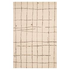 Anchor your living room seating group or define space in the den with this loomed rug, featuring an abstract grid motif for eye-catching appeal.