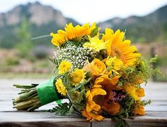 Sunflower and mixer of yellow shade flower  bridal bouquet.