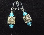 light blue and silver colored charm earrings