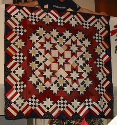 Americana stars and stripes quilt.The patterns are from Judy Martin, from a past bom, but a similar patterns on a cd call Star Power from EQ Company