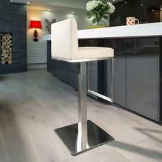 Luxury ivory/cream kitchen breakfast bar stool/seat/barstool 210I. Ultra Stylish Modern High Quality Barstool from the Quatropi Design Studio. Commercial standard heavy duty faux leather stool with brushed stainless steel stem and base. Call 02476 642139 or email sales@quatropi.com or visit www.quatropi.com for additional information.