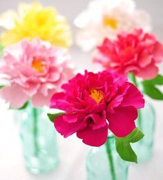 Clay peony bloom in aqua vase