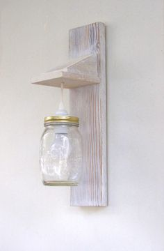 Handmade Wall Lamps made of recycled treated wood painted and distressed finish. Mason jar creates in the space sweet nostalgic and warm atmosphere. Ιdeal for places that need to have a welcoming and intimate ambience. It is hard wired for installation of a power supply that exists on