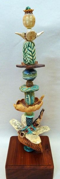 Occidental Pottery and Wood - Garden Totems                                                                                                                                                      More