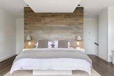 This is a clever way to use laminated boards to create a 'wall' in a neutrals-based enivronment