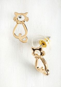 Purr-a Vida Earrings. Wherever you roam, youve gato keep these gold cat earrings by your side! #gold #modcloth
