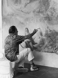"""Salvador Dalí in his studio in Cadaques, Spain wearing """"Dali"""" espadrilles (named after the famous painter) Charles Darwin, Famous Artists, Great Artists, Cadaques Spain, Salvador Dali Art, Karl Marx, Friedrich Nietzsche, Foto Art, Portraits"""