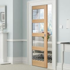 Single Pocket Contemporary Oak 4 Panel Door with Clear Safety Glass - Prefinished - Lifestyle Image.    #slidingdoor #oakdoor