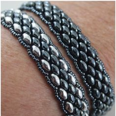 A couple of Super Duo bracelets in Hematite and Silver using Kelly Dale's Youtube video. She makes a triple wrap bracelet, I just made regular length. http://youtu.be/cB9_BHbYBV0