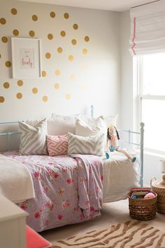 Gold spots on the wall - great idea for a teen or tweenager  Adrienne Gilliam's Indianapolis Home Tour | The Everygirl