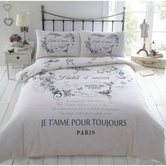 Part of our vintage-inspired collection, this poly-cotton bedding set captures the charm and romance of a Parisian hotel. Featuring a typographical French print on a cream coloured base, it is framed by delicate blue floral motifs which continue onto the duvet cover reverse.