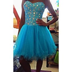 Aqua blue corset dress Lots of bling on the bodice, tulle skirt, fits great. Worn once. Dresses Mini
