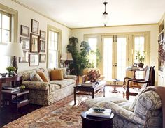 Designer Robin Bell covered the sofa, armchair, and ottoman in this New York summer home's study in antique toile.