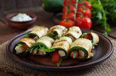 Rolls of zucchini with tomatoes and cheese