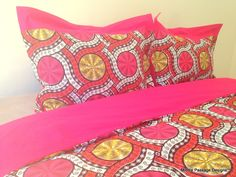 A dazzling 100% cotton wax fabric duvet cover with a bright and colorful design. This duvet cover  is 100% cotton and handmade with a solid fuchsia back and a zipper closure.  The pictures display the duvet cover in both indoor and outdoor natural light.This duvet cover has been pre-washed, so the colors are as vibrant as you see.