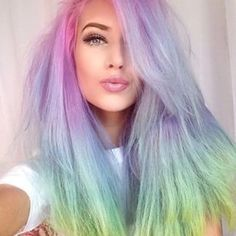 Her hair is like an ocean of awesomeness.   Pastel Rainbow Hair Is Basically The Prettiest Thing Ever