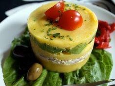 Peruvian Causa- Potato, avocado, crab (spicy tuna or shrimp), lime, aji amarillo paste (yellow pepper sauce)