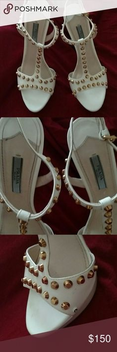 Prada heels White with gold studs. Missing a gold stud but hardly noticeable. See pic. Bag included. Prada Shoes Heels