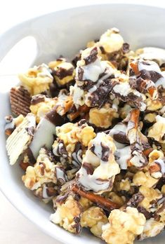 Potato Chip Pretzel Caramel Corn is the perfect snack mix for a movie! You get a nice balance of salty and sweet with this recipe. Make it for your friends on movie night!