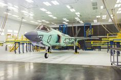 AM-1 in Final Finishes by Lockheed Martin    Via Flickr: The first F-35 for Norway, known as AM-1, in the Aircraft Final Finishes (AFF) facility, where it receives low observable coatings. From this station, the aircraft will undergo a series of functional fuel system checks and then transport to the flight line for operational ground checks and its first flight.