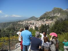 Renata is pointing out the bay under Taormina