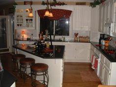 Kitchen remodel; granite counters, white cabinets, island