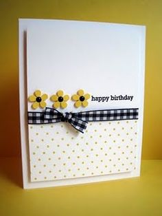 tiny paper flowers, use of yellow and black, gingham ribbon