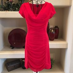 Express Red Dress Express red dress, draped transparent overlay in the front and back, stretchy throughout to hug your curves, 57% cotton, 38% modal, 5% spandex, overlay is 100% polyester. Size is small petite. Express Dresses