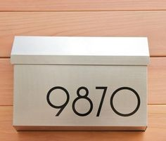 house numbers.  Not this font or color but the idea of it being large and on the mailbox!