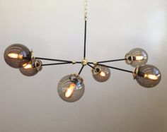 VIDEO: https://vine.co/v/eA50envDtVE  This brass reef chandelier is MADE TO ORDER with a typical lead time of 4 weeks. Fixture lead time can be